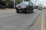 Mặt đường Quốc lộ 1 bị hằn lún vệt bánh xe