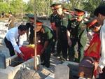 Truy điệu và an táng hài cốt quân tình nguyện Việt Nam hy sinh tại Lào