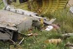 Thi thể vương vãi quanh hiện trường máy bay Malaysia rơi