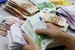 Euro xuống giá sau tin cứu trợ ngân hàng Bồ Đào Nha