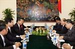 Phó Thủ tướng Nguyễn Xuân Phúc hội đàm với Phó Thủ tướng Lào