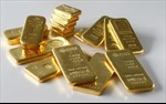 Giá vàng mất đà tăng, dầu vẫn giảm