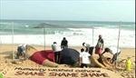 Tượng cát khổng lồ tưởng nhớ cậu bé Syria dạt vào bờ biển
