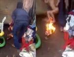 """Cha dượng """"nướng"""" con trên lửa vì làm ướt giường"""
