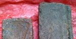 Phát hiện hai khuôn đúc đồng cổ bằng đá