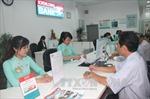Đẩy mạnh cơ cấu các tổ chức tín dụng và xử lý nợ xấu