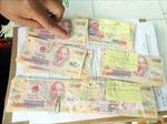 Phá đường dây đưa tiền giả từ Trung Quốc về Việt Nam tiêu thụ, khởi tố 7 đối tượng