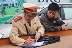 """Hà Nội cấm giữ xe trên 262 tuyến phố: Lái xe """"méo mặt"""" ngày đầu xử phạt"""