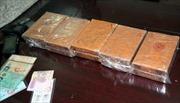 Lai Châu bắt hai người mua bán 10 bánh hêrôin