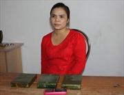 Mang 7 bánh heroin vượt biên sang Trung Quốc
