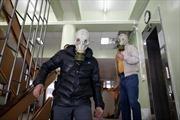 Putin kêu gọi lực lượng ly khai Ukraine hoãn trưng cầu dân ý