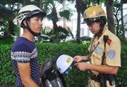 Ngày đầu 'xiết' mũ bảo hiểm: Tuyên truyền, nhắc nhở là chính