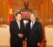 Phó Thủ tướng Nguyễn Xuân Phúc tiếp Đoàn đại biểu cấp cao TTX  Pathết Lào
