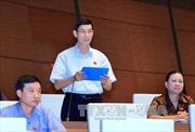 Thông qua Nghị quyết về Quyết toán ngân sách năm 2013
