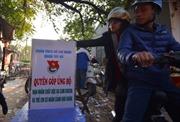 Thanh niên tình nguyện Thủ đô trông giữ xe miễn phí ngày Tết