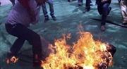 Dùng xăng đốt vợ, nhận án 18 năm tù