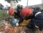 Hai đối tượng lạ vứt hai bình khí cực độc trên đại lộ Phạm Văn Đồng