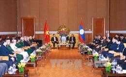 Tổng Bí thư Lào gặp gỡ cựu binh tình nguyện Việt Nam