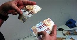 Khách Trung Quốc tăng, phát hiện thêm nhiều tiền giả tại Hàn Quốc