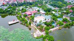 Hà Nội xử lý kiên quyết vi phạm về đất đai tại hồ Đầm Trị để làm gương