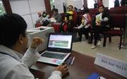 Ngày đầu tiêm vắc xin đăng ký qua mạng tại Hà Nội