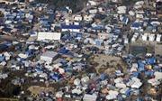 """Pháp bắt đầu xóa sổ """"rừng tị nạn"""" Calais"""