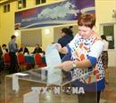 Chùm ảnh: Cử tri Nga tại Việt Nam đi bỏ phiếu bầu cử tổng thống