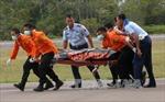 Một thi thể mặc áo phao được trục vớt trong vụ máy bay mất tích