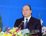 Mít tinh kỷ niệm 40 năm Hội hữu nghị Việt Nam - Lào