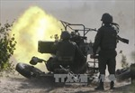 Các bên xung đột tại Ukraine bắt đầu rút vũ khí hạng nhẹ