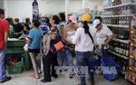 Venezuela nới lỏng lệnh đóng cửa biên giới với Colombia