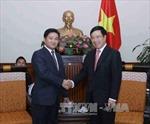 Phó Thủ tướng Phạm Bình Minh tiếp Đoàn đại biểu cấp cao Đoàn Thanh niên Nhân dân Cách mạng Lào