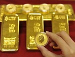 Vàng lùi dần về mốc 1.700 USD/ounce