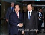 Hội nghị Cấp cao đặc biệt ASEAN - Australia: Thủ tướng Nguyễn Xuân Phúc gặp Thủ tướng Lào