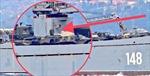 Một ngày sau trận không kích, tàu chiến Nga lừng lững chở xe bọc thép tới Syria