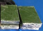 Bắt đối tượng 'ôm' 6 bánh heroin từ Lào về Việt Nam