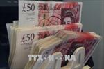 Đồng bảng Anh rơi xuống mức 'đáy' của 13 tháng