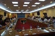 Tăng cường phối hợp công tác giữa TTXVN và Hà Nội