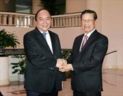 Phó Thủ tướng Nguyễn Xuân Phúc tiếp đón Phó Thủ tướng Lào