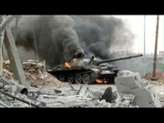 Xe tăng IS tan xác ở Kobane
