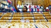Giá vàng hạ xuống dưới 1.200 USD/ounce