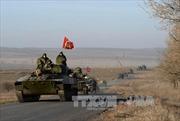 Các bên tại Ukraine tiếp tục rút vũ khí hạng nặng