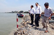 Móc lên toàn bộ đất đá lấn bờ sông Đồng Nai