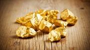 Giá vàng nhích lên từ mức thấp gần sáu năm