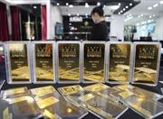 Mỹ-Triều căng thẳng, giá vàng thế giới vọt cao nhất hai tháng