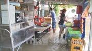 Triều cường dâng cao, người dân Bình Dương 'bì bõm' trong nước