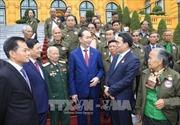 Chủ tịch nước gặp mặt đại biểu công dân Lào có công với cách mạng Việt Nam