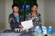 Bắt quả tang hai người Lào mua bán 3 kg thuốc phiện