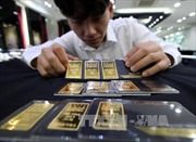 Giá vàng và dầu đồng loạt sụt giảm; Chứng khoán Âu - Mỹ biến động nhẹ