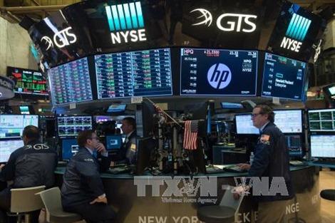 Chứng khoán Mỹ phản ứng trái chiều sau quyết định tăng lãi suất của FED